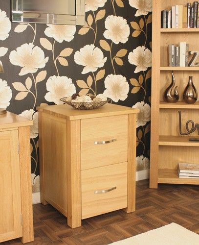 This Aston Oak Two Drawer Filing Cabinet is a part of Aston and a great Home Office Storage.  The dimension of this Aston Oak Two Drawer Filing Cabinet are as follows - the height is 80CM, the width is 52CM the depth is 55CM and the volume of this Aston Oak Two Drawer Filing Cabinet is 0.23CBM.  The International Article Number or EAN number is 5060164712275 and the weight is 39.00kg.  This Aston Oak Two Drawer Filing Cabinet is an authentic Baumhaus product and Bonsoni is proud to be an…