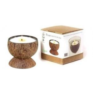 Une boule coco avec à l'intérieur une bougie pour le massage parfumée à la mangue
