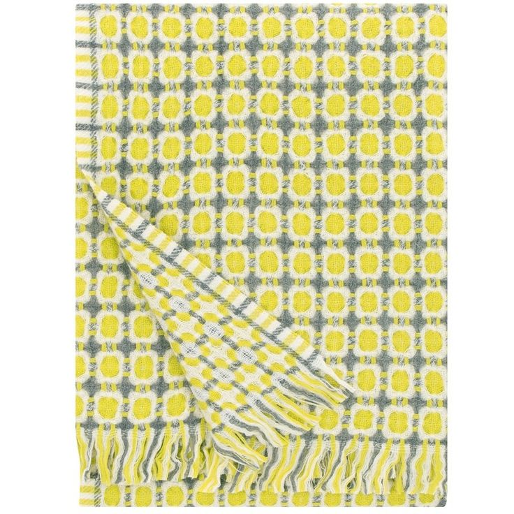 A gentle repeating dot design with circle detailing & soft fringe edging makes this pretty corona blanket by Maja Rautiainen a must have to create your cosy living space with a Scandinavian feel. With complimentary hues of yellow pistachio green, grey & white this will bring a softness & warmth to your styling and a timeless design from Finnish textile company Lapuan Kankurit, means it will always look great. A matching cushion is also available as are other colour options in this range.
