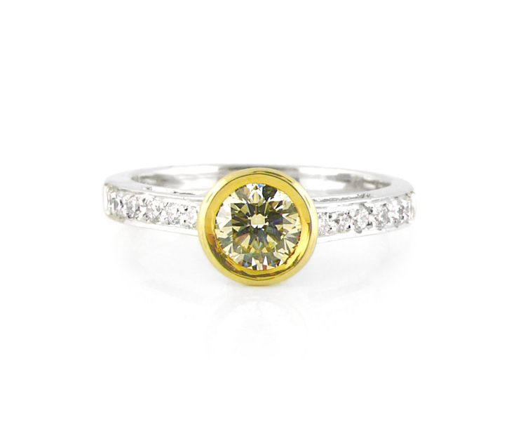 An 18ct White and Yellow Gold Diamond Ring with a Fancy Cape Diamond in the Center