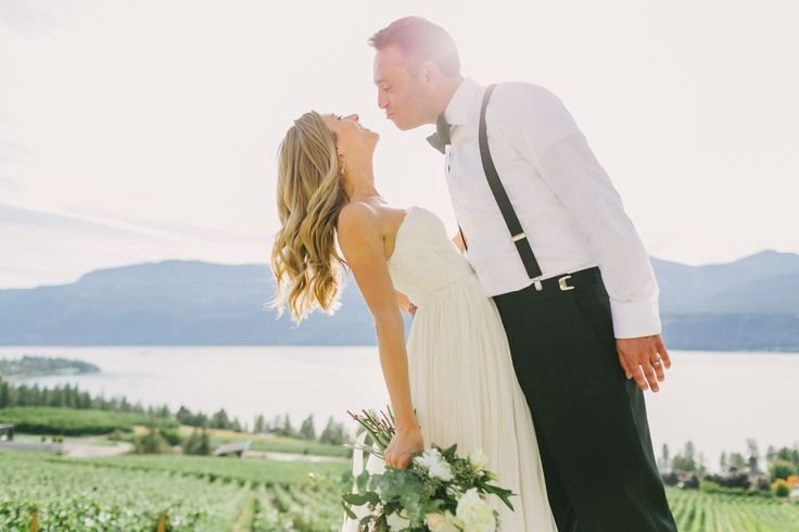 Vineyard Kiss - Possibly the most beautiful outdoor event location with the best view in the Okanagan Valley can now be reserved for special functions. The 'Infinity Event Pad' is a breathtaking vista featuring a 3,000 sq-ft concrete infinity pad that visually drops into the vineyards and lake below. It is the most stunning outdoor setting for a wedding ceremony and reception. Photo Credit: Shawn Talbot ~ Visit www.50thParallel.com for our Wedding packages.