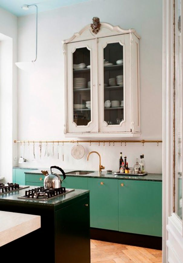 ECLECchic: Kitchens The hooks over the sink. I'd like a different color than green,but it's really nice.