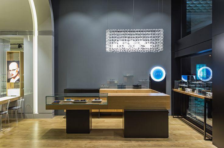 XYZ Arquitectos Associados - Óptica Médica Rogério - Matosinhos - Portugal - interior design - optical store - Giogali pendant light Vistosi