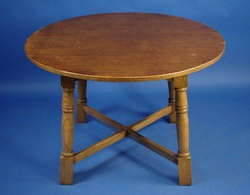Antique Round Oak Dining Table by English Classics. $650.00. This beautiful antique style oak dining table was crafted in England around 1950. Over the past 60 years, the table has acquired the beginnings of a lovely patina, which enriches the distinct grain and lustrous complexion of the oak. Simple yet elegant turned legs and a sturdy x-frame provide strong support, which helps to explain why this table remains so sturdy after several decades. The simple desi...