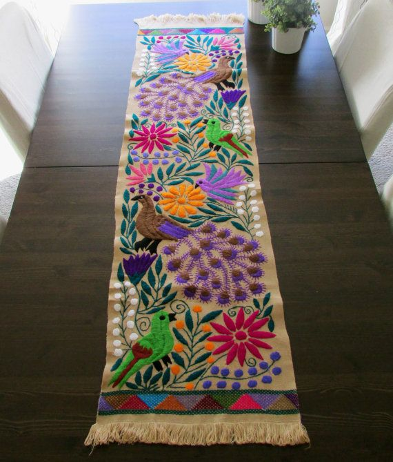 Beautiful Table runner color beige as main color with embroidered Peacocks in brown and violet, hummingbird other birds and colorful flowers.
