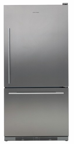 Kitchen Fridge - This stainless steel fridge has a simple design and chrome handles, also it works well with the other stainless steel and chrome features in this kitchen