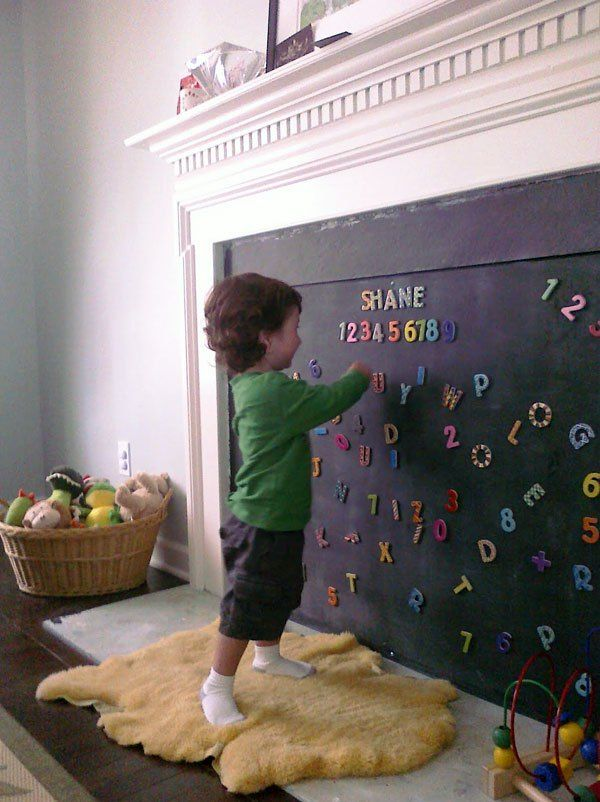 Turn your fireplace into a creative space with plywood and some chalkboard paint