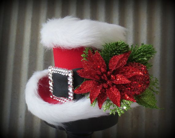 Santa approved, super cute Christmas Mini Top hat! The base is a lovely textured duck clothe with a black satin sash. The buckle is mock rhinestone
