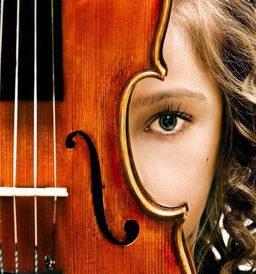 I like this photo because it's non-traditional. Adding the violin adds a whole new dimension to the girl that we would have not known before.