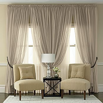 I love the sheer neutral curtains. Perhaps I'd leave the middle curtains all sheer