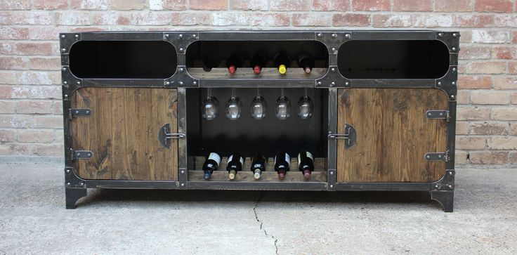 The FreightBar Industrial Wine Cabinet The FreightBar The FreightBar is an industrial style wine cabinet / sideboard built to emulate an old vintage metal tool chest. However now it can hold bottles of wine, wine glasses and offers plenty of storage to store serving plates, dinnerware, glassware or even large punch bowls. Features Angle iron Read More ...