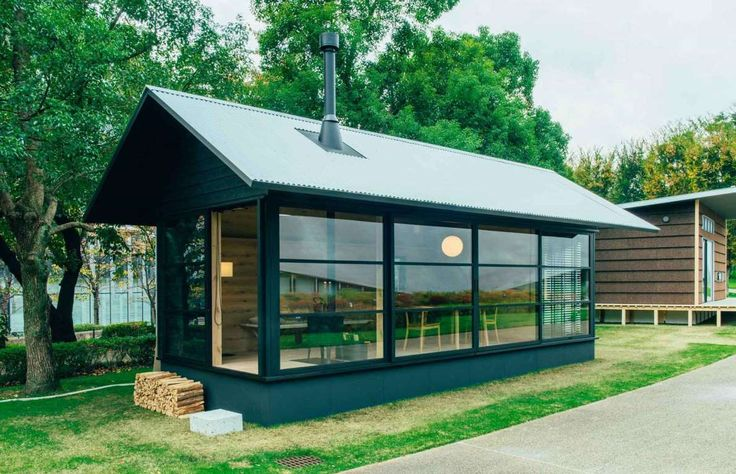 Muji's larger Wooden Hut is nice and bright thanks to the glass panels and features a cast iron stov... - Muji