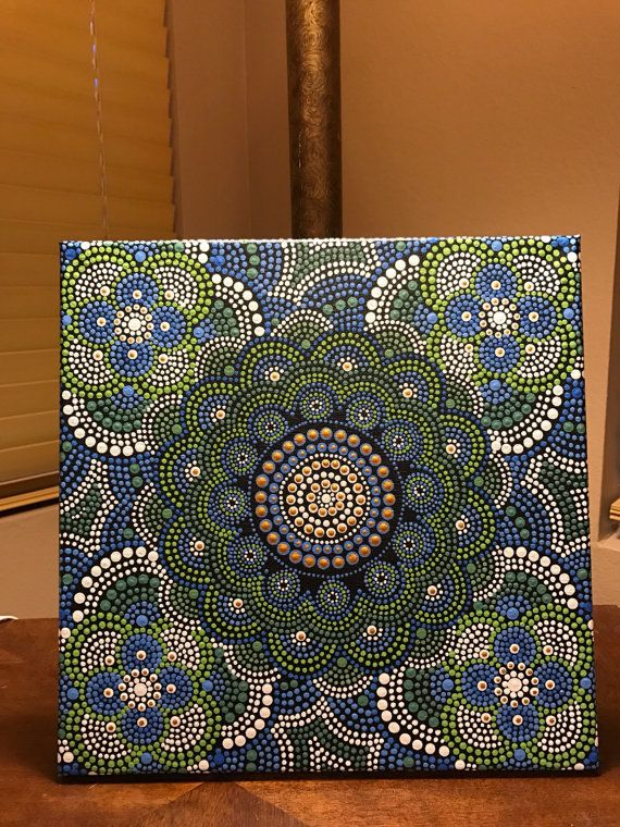 This is a handmade 12 inch by 12 inch canvas. Brushes and other tools are used for different size dots. Final coating is done with high quality satin varnish. A mandala is a sacred space, often a circle, which reveals inner truth about you and the world around you.