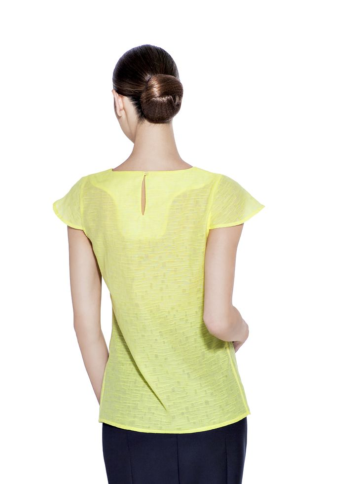 In sunlit yellow this essential cotton and silk blend blouse will brighten up your outfit. With gentle front folds, short sleeves and a keyhole buttoned back is a perfect fit to add to your work wear. Fabric imported from Italy: 25% Silk 75% Cotton Washcare: Dry clean MADE IN EUROPE