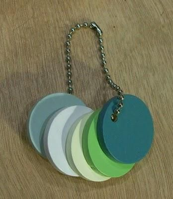Make a keychain with pieces of wood painted in the colors of your walls and furniture. It would be so handy to have if you're out somewhere and you see curtains, or a nice chair - you'll be able to tell if it would clash horribly with your walls or other furniture.