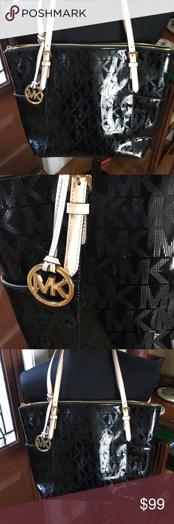 Michael Kors tote Beautiful black Michael Kors tote measures app. 10x13 can easily fit a tablet or small laptop in it. Great for work or everyday. In Excellent condition . Feel free to ask any questions KORS Michael Kors Bags Shoulder Bags