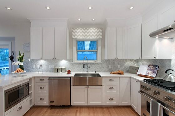 Kitchen: Grey backsplash, white cabinets, stainless ...