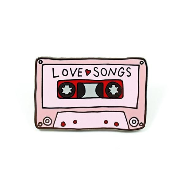 "Can you name two things that make the world go round? How about love and music?! Now you can rep both with this Love Songs Mixtape pin by Abby Galloway - 1.25"" Hard Enamel - Design by Abby Galloway"