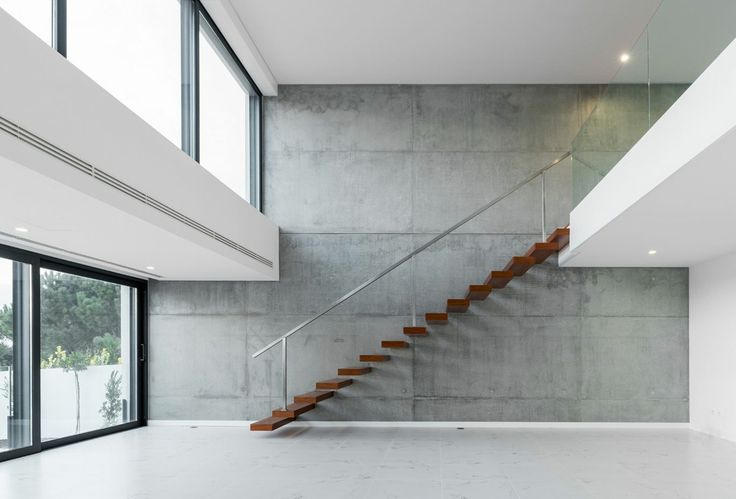 concrete wall + floating stairs / Valadares House