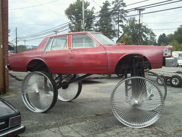pictures of the most craziest donk cars and high risers shared via slingpic