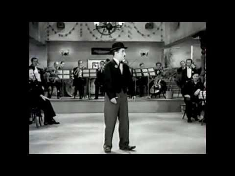 "Charlie Chaplin sings ""Titina"" from his 1936 movie""Modern Times"" with among others the actress Paulette Goddard"