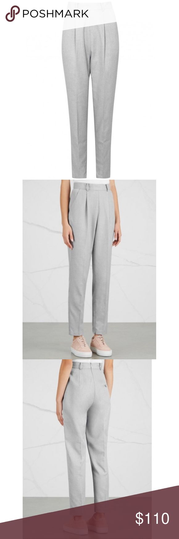"""NWT! Finders Keepers Trouser Pants I am selling these very fashionable and chic high waisted gray  Trouser slack pants by Finders Keepers, size Large. I got them on Yoox for $121 plus tax and shipping. Retail for $150 on other websites. The waist fits me (a little loose) but the butt/thigh area are loose and I think would fit someone better who has a booty and thicker legs. Waist is 15"""" across. Very pretty and flattering even though they are a bit big on me. There are tiny zippers next to…"""