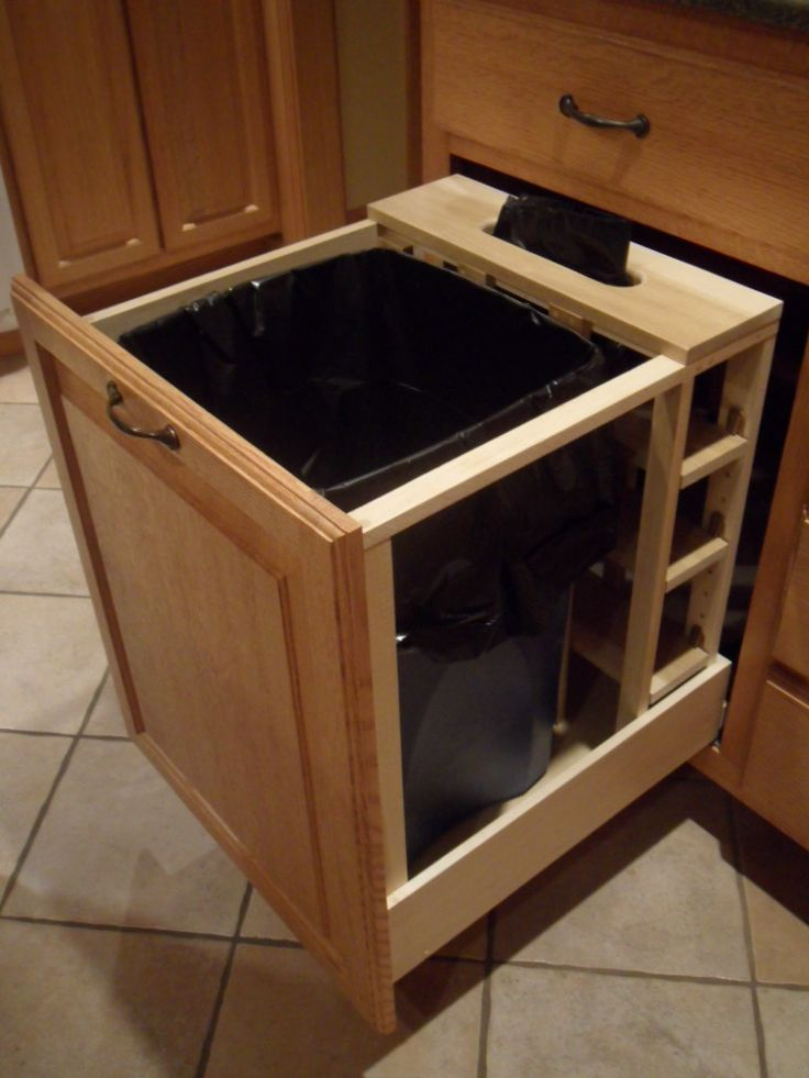 *pull-out trashcan w/slotted place in the back to store/pull extra bags