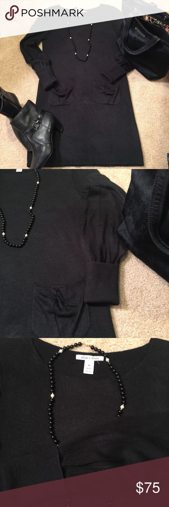 Alice $ Olivia Black Sweater Dress Very cute sweater dress. Has two front pockets. The sleeves have a different pattern than the dress. Sleeves role up to make a cuff. Material is 100% acrylic. Alice + Olivia Dresses Long Sleeve