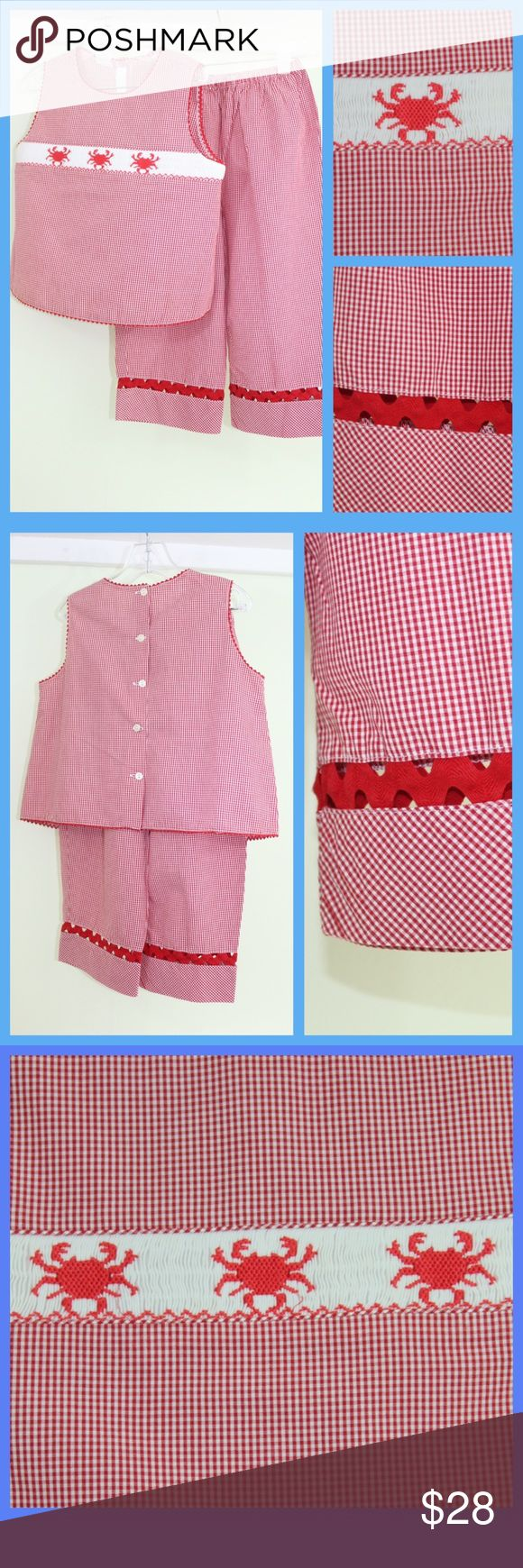 Vive la Fete,  Crabby Fun! Red Gingham Smocked Set Vive le Fete Crabby Fun! Red Gingham Sleeveless Smocked Outfit  - Two piece, sleeveless pants outfit - Smocked Inset of Three Red Crabs 🦀  - Red and White Gingham/Check - Trimmed in red ric-rac at arms and neck - Unique cutout ric-rac accent near hem of pants - Elastic waist - Condition is Flawless Vive la Fete Matching Sets