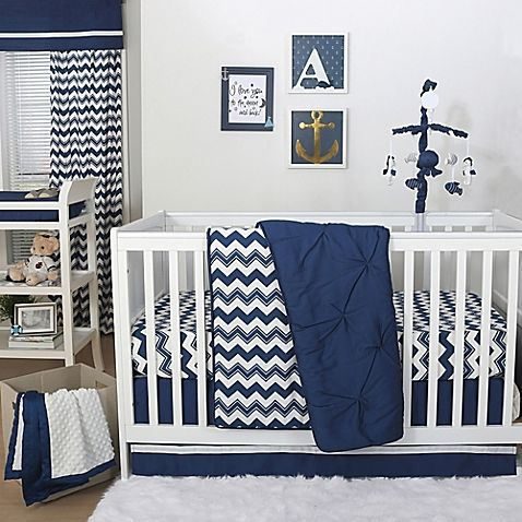 Surround your little one with classic style and comfort. Crisp navy and white in solids and a bold chevron print, plus super-soft cotton sateen fabric, combine to create a fun nursery with this Pintucked Crib Bedding Collection from The Peanut Shell.