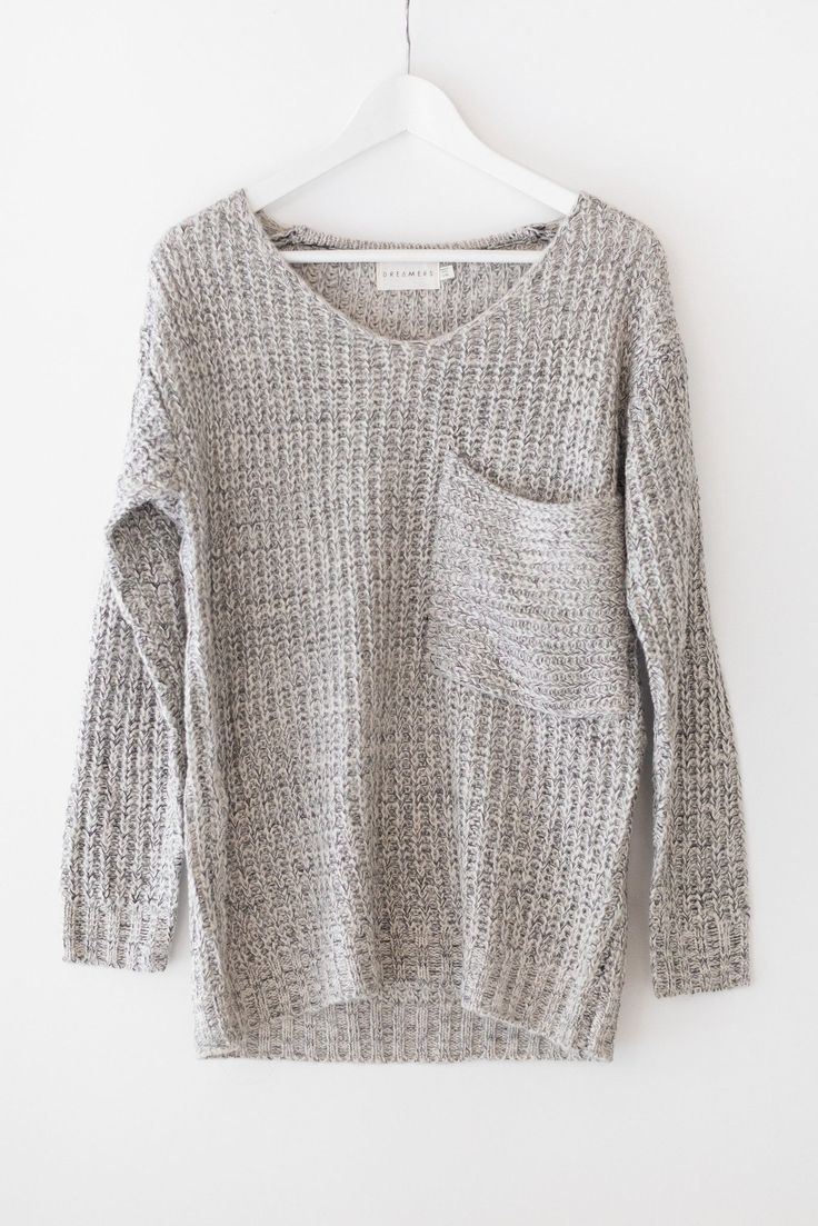 Multi colored knitted sweater with an oversized fit and a large front chest…
