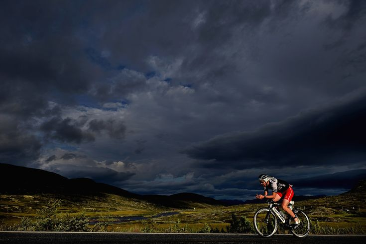 A triathlete cycles across the Hardangervidda mountain plateau during the Norseman Xtreme Triathlon on Aug. 3 in Eodfjord, Norway. (Jeff J M...