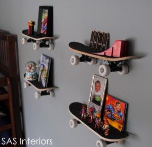 """I did a similar thing for my teen sons room using his broken skateboards ( he himself had salvaged the wheels and trucks so they arent on) and """"L"""" brackets which cost me $3.00 for 10 of em. The grip tape already on the top of the board helps keep things in place. I also hung his snowboard as wall art at his request. :)"""