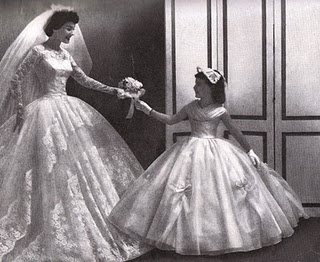 A beautiful 1958 image of bride and flower girl/junior bridesmaid.