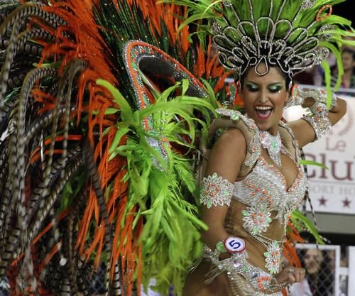 """Dancers perform during carnival in Encarncion, 375 kilometers south of Asuncion on February 15, 2014. The """"Llamadas"""" is Paraguay's biggest carnival parade, in which """"comparsas,"""" groups of dancers and drummers compete."""