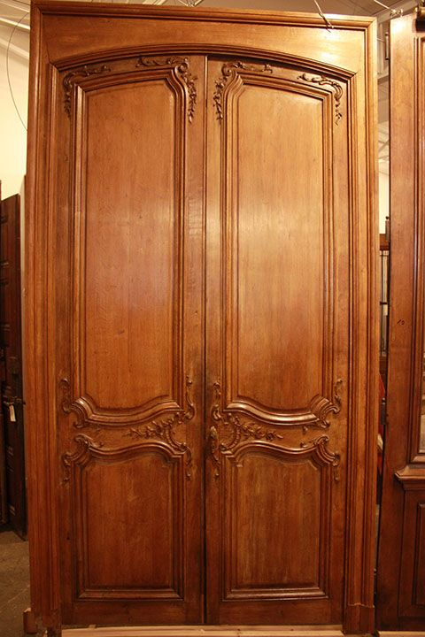 Office Door - This French Oak Double Door is ornately carved on both sides. Original jam, interior and exterior trim and all hardware is intact. 59x111  - 7800 c. 1840.