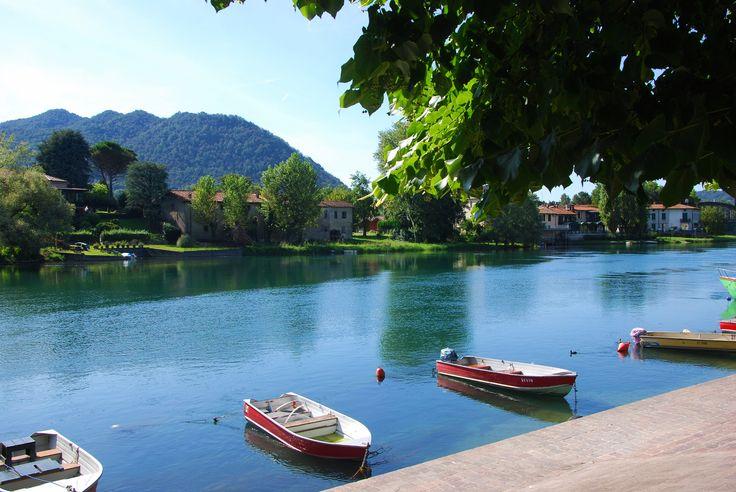 Adda - Boats, river Adda, trees, reflections - Brivio, Lecco, Italy.