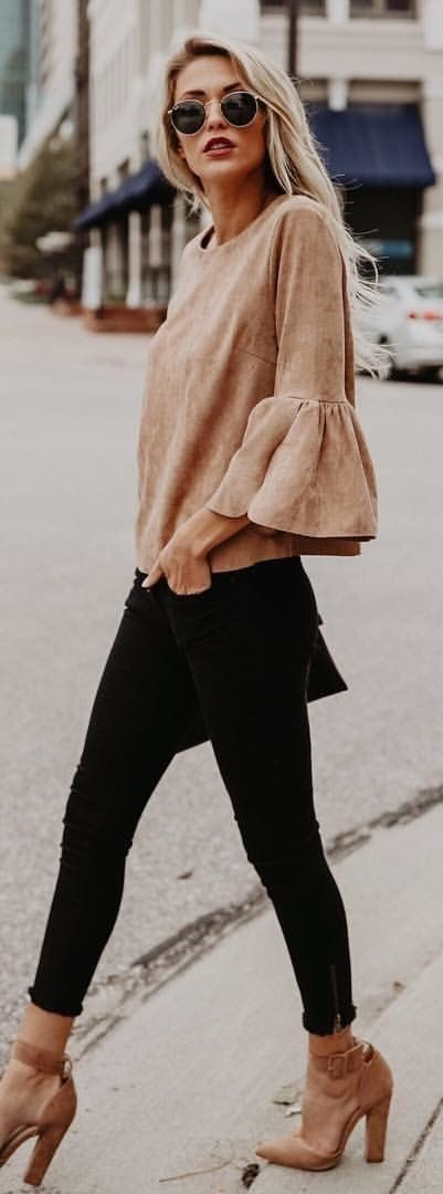 Beige suede top and shoes with black mini skirt and leggings.