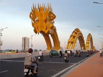 7 Awesome Buildings That Look Like They're Designed by Kids | Cracked.com The dragon puts on a pyrotechnics show every evening at nine o'clock, and at night the bridge is lit up by over 2,500 LED lights.