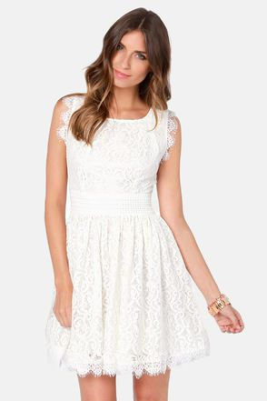 Check it out from Lulus.com! The Darling Angelina Ivory Lace Dress is a positively picturesque way to show off your angelic side! Heavenly ivory lace tucks into a few pleats at the sweet scoop neck, before flowing down the sleeveless bodice to a flattering banded waist. The gathered full skirt is extra graceful thanks to a scalloped hem, and a bit of tulle lining for a subtle feminine flare. Hidden back zipper/hook clasp. Lined. Model is wearing a size x-small. Shell: 57% Cotton, 37% Nylon…