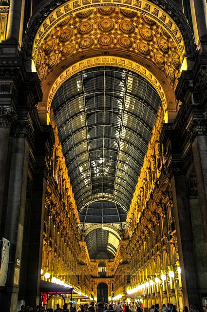 The Golden Glow of Lights in the Galleria Vittorio Emanuele II at Night Milan Italy