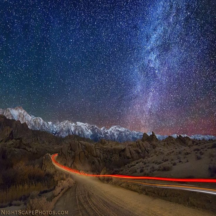Starlight Road ~ Car lights leave light trails on a dirt road through the Alabama Hills, under a starry night sky. Late November's new fallen snow on Mt. Whitney and the Eastern Sierra Mountains near Lone Pine, California. Photo Credit: Royce Bair @ roycebair.com