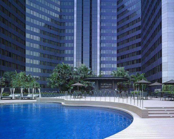 Relax at Grand Hyatt Taipei pool with its lush landscape, stylish yet comfortable sun beds, lounge areas and a pool bar.