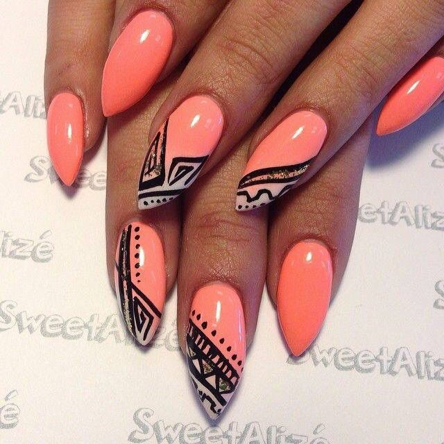 I love these tangerine pink almond tip nails with black line art!
