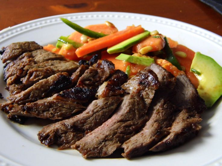 Papaya Marinated steak w/ papaya salad. Plus use papaya skin on your face to remove dry skin!