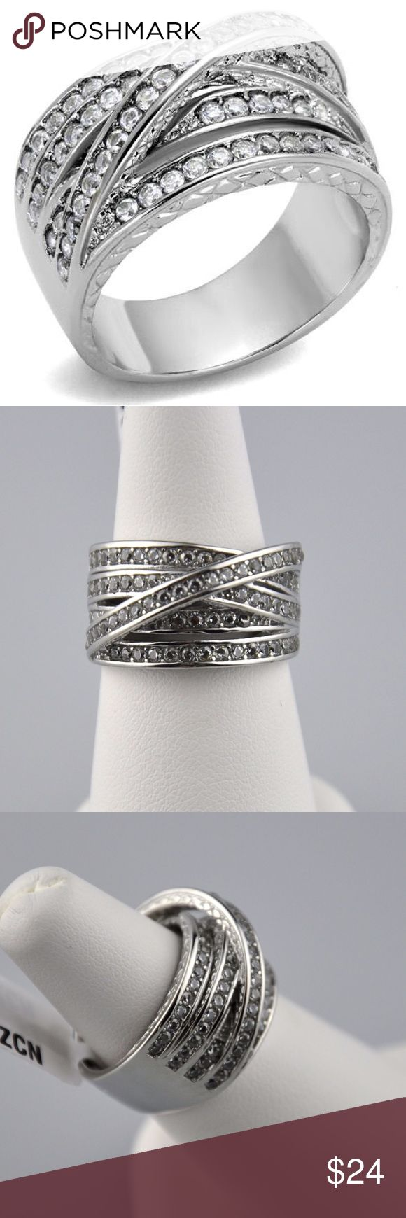 AAA Cubic Zirconia Stainless Steel Statement Ring This is a truly unique ring. Multiple lines of clear cubic zirconia stones offer tons of sparkle. The perfect finishing touch to any outfit. All set in a stainless steel band. Stainless steel is hypoallergenic, easy to care for, will not tarnish and will not turn you finger green. Smoke free pet friendly home. Jennies Jewelry Chest Jewelry Rings
