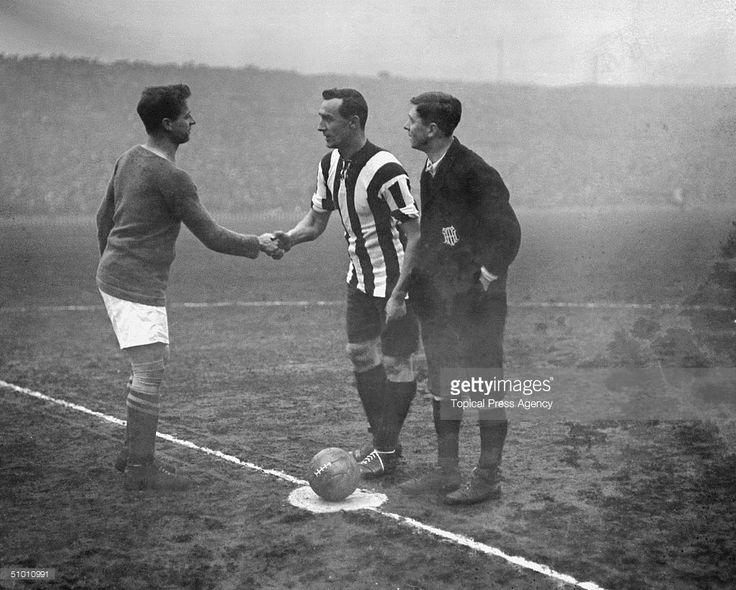 The captains of Chelsea (left) and Sheffield United shake hands before the start of the FA Cup Final at Old Trafford, which United won 3-0, 24th April 1915.