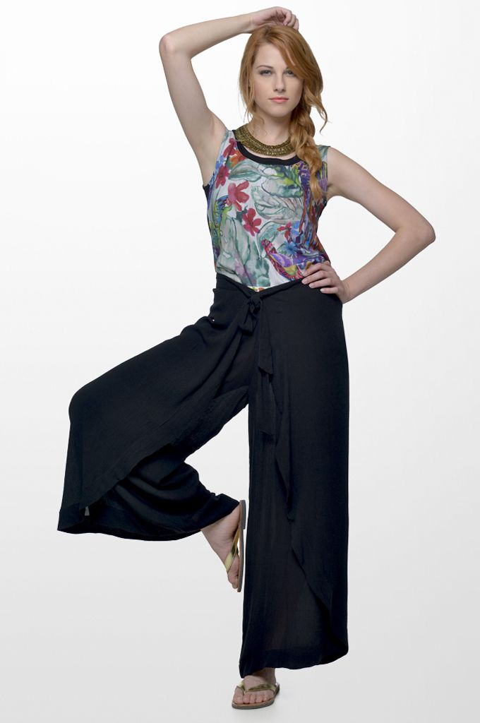 Sarah Lawrence - sleeveless printed top, tie-waist wide legged trouser, necklace.