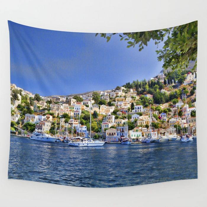Buy Symi island in Greece. Traditional houses. Sunny day with blue sky and sea. Wall Tapestry by ibphotos. Worldwide shipping available at Society6.com. Just one of millions of high quality products available.