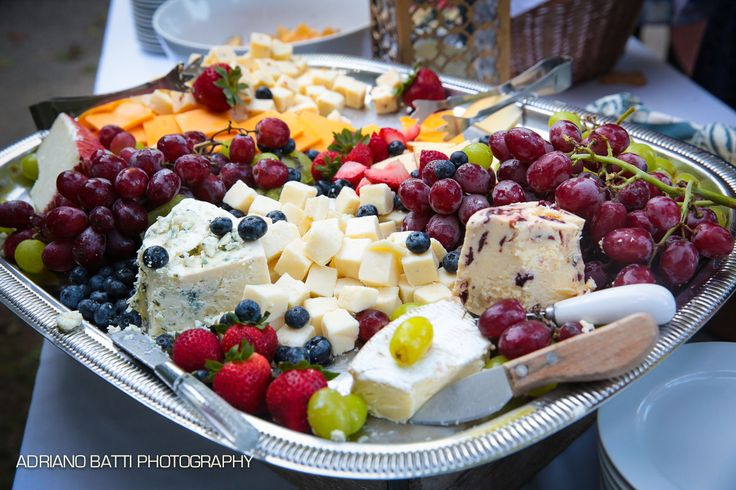 Sliced cheeses, brie & imported blue cheese with grapes, seasonal fruit, berries & assorted crackers. Photo credit adrianobatti.com
